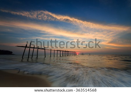 sunset and sea, Old bridge at Pilai beach in sunset time. Takua Thung District , Phang nga , Thailand. Long exposure - stock photo