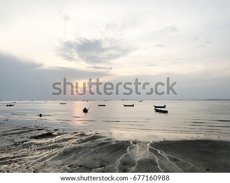 SUNSET AND SEA SAND WITH BOATS NICE CLEAR SKY