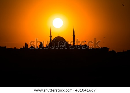 sunset and silhouette of a mosque in Istanbul