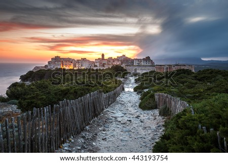 Sunset and storm over the Old Town of Bonifacio, the limestone cliff, South Coast of Corsica Island, France - stock photo