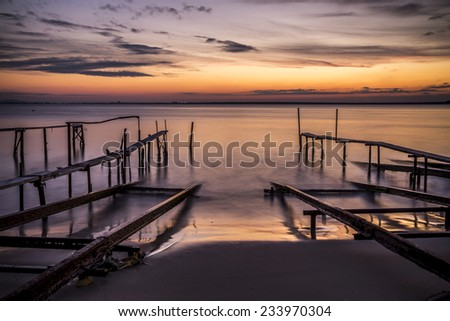 Sunset and the fishing pier - stock photo