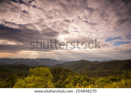 Sunset and the sun is shining in the valley. - stock photo