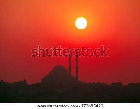 Sunset and Yavuz Selim mosque, Istanbul, Turkey - stock photo