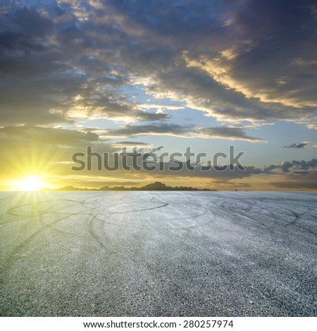 Sunset asphalt asphalt tire marks - stock photo