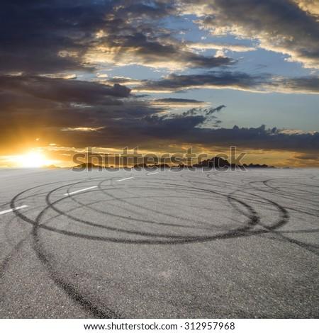 Sunset asphalt asphalt tire marks - stock photo