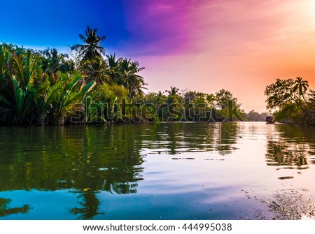 Sunset at a beach resort in the tropics. Beautiful landscape image.