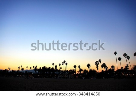 Sunset at a Santa Barbara beach looking towards the city. - stock photo