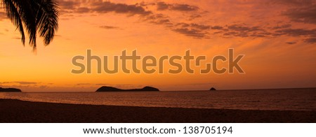 Sunset at a tropical beach, Palm Cove, Queensland, Australia - stock photo