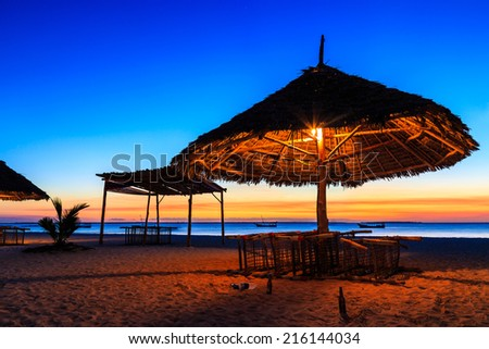 Sunset at a tropical resort near the ocean - stock photo