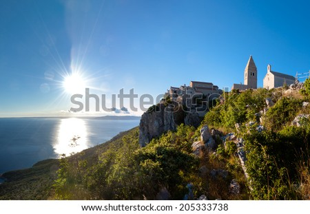 Sunset at Ancient town of Lubenice and cliff in Cres - Croatia - stock photo