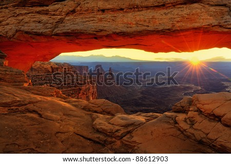 Sunset at Balanced Rock in Arches National Park near Moab, Utah - stock photo