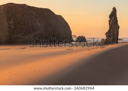 Sunset at Bandon Beach in Southern Oregon Coast, Pacific Ocean, USA - stock photo