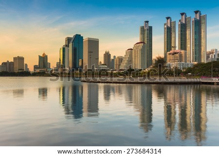 Sunset at Bangkok city downtown with reflection of skyline, Thailand - stock photo
