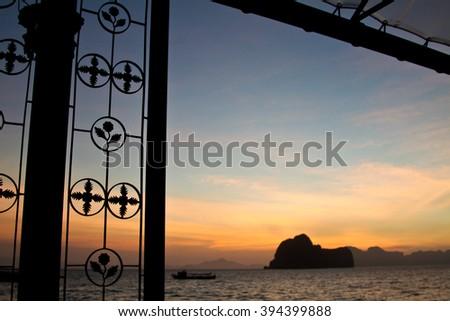 Sunset at beach on an island in Krabi Thailand - stock photo