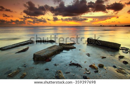 Sunset at beach,Soft focus because of slow shutter speed - stock photo