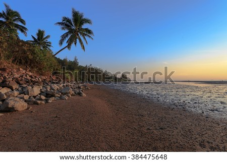 Sunset at beach with blue sky