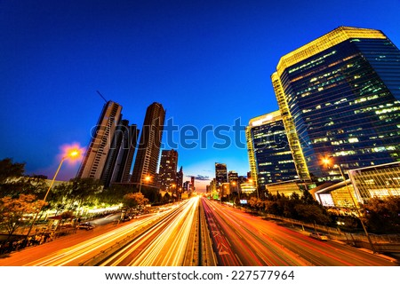 Sunset at Beijing. Downtown office building - stock photo