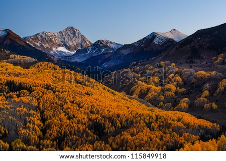 Sunset at Capital Peak with the yellow aspen forest, Aspen, Colorado - stock photo