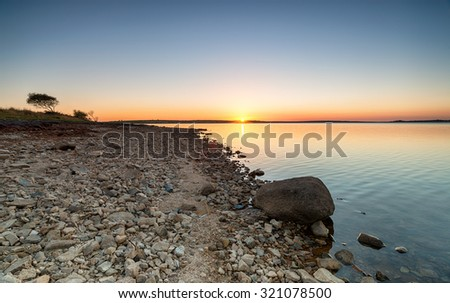 Sunset at Colliford Lake on Bodmin Moor in Cornwall - stock photo