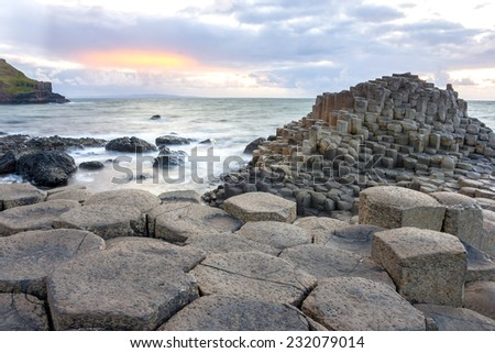 Sunset at Giant s Causeway in North Antrim, Northern Ireland - stock photo