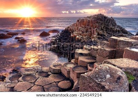Sunset at Giants Causeway in North Antrim, Northern Ireland - stock photo