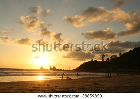 sunset at goa beach, karnataka, india - stock photo