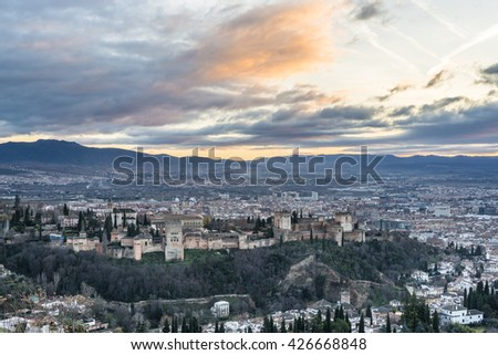 Sunset at Granada - The panorama of Alhambra palace and fortress complex at dusk. Andalusia. Spain - stock photo