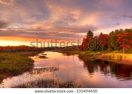 Sunset at Hamlet of Lake Pleasant in fall, Adirondack, NY. - stock photo