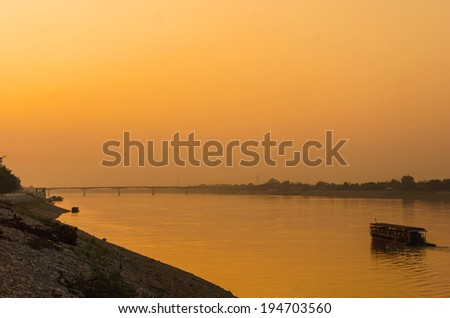 Sunset at home port in Mekong river, Laos. - stock photo