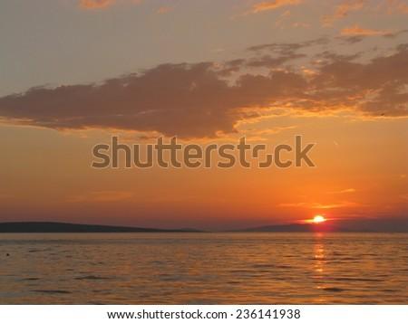 Sunset at Ist in the Adriatic sea of Croatia - stock photo