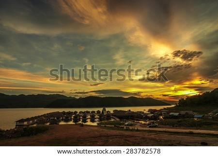 Sunset at lake - stock photo