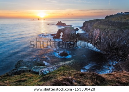 Sunset at Lands End Cornwall England UK showing the rock formations of Enys Dodman and the Armed Knight - stock photo