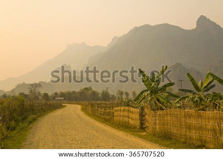 Sunset at limestone mountains of Vang Vieng, Laos