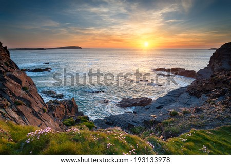 Sunset at Longcarrow Cove near Padstow in Cornwall - stock photo