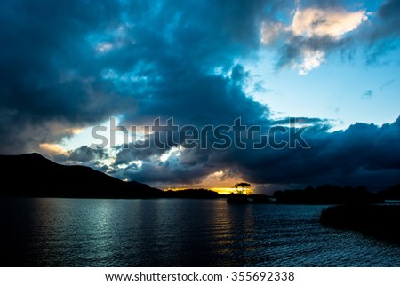 Sunset at Lough Leane in Killarney National Park in Ireland - stock photo