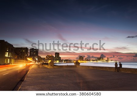 Sunset at Malecon, the famous Havana promenades where Habaneros, lovers and most of all individual fishermen meet, Havana, Cuba  - stock photo