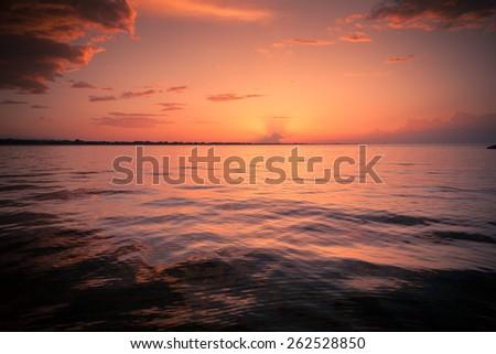 Sunset at Mediterranean Sea at Summer time - stock photo