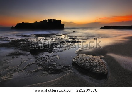 Sunset at Melasti beach  in bali indonesia island one of the fabulous place to visit when you in Bali. - stock photo