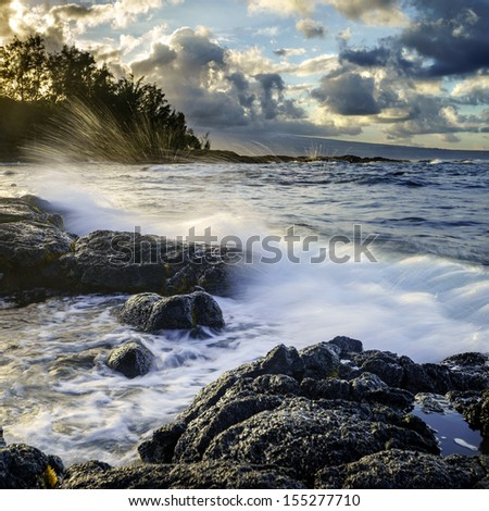 Sunset at ocean coast in Hilo, Hawaii, Big Island.