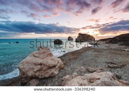 Sunset at Petra tou Romiou, the birthplace of Aphrodite. Paphos. Cyprus. - stock photo