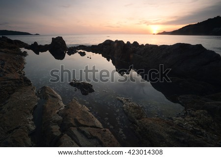 Sunset at Phuket beach - stock photo