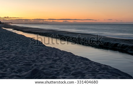 Sunset at pikowai beach, New Zealand - stock photo
