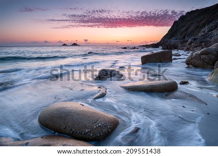 Sunset at Porth Nanven Beach in Cot Valley near Penzance in Cornwall