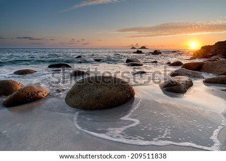Sunset at Porth Nanven Beach in Cot Valley near St Just in Cornwall - stock photo