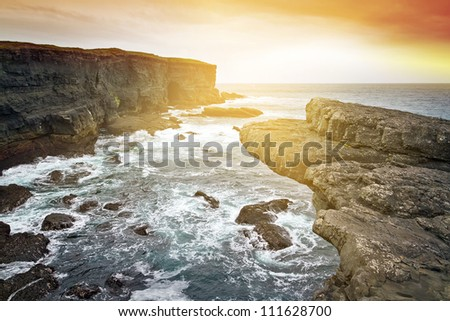 Sunset at raw cliff scenery i Ireland - stock photo