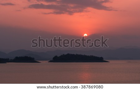 Sunset at reservoir near dark in thailand - stock photo