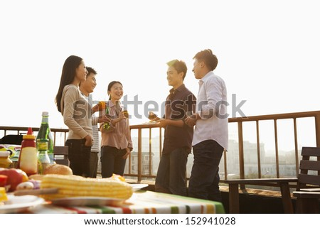 Sunset at Rooftop Barbecue - stock photo
