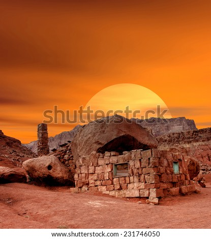 Sunset at ruined Abandoned Frontier Stone House - stock photo