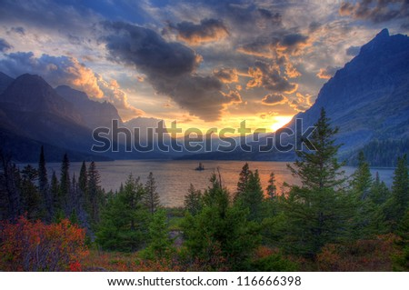 Sunset at Saint Mary Lake and Wild Goose Island, Going To The Sun Road, Glacier National Park, Montana, America - stock photo