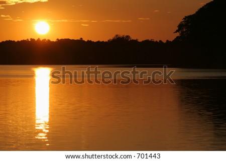 Sunset at Sandoval oxbow lake, near Puerto Maldonado, Peru (Amazon) - stock photo
